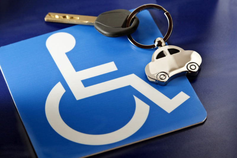 Wheelchair symbol and a set of car keys