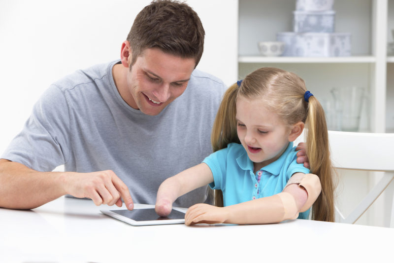 Adult and child using an iPad
